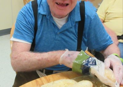 Bobby making garlic bread